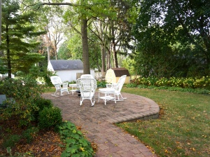 back-yard patio with white wicker chairs